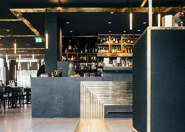 Munich s brassy herzog bar would fit the foot of our for Interior design munich